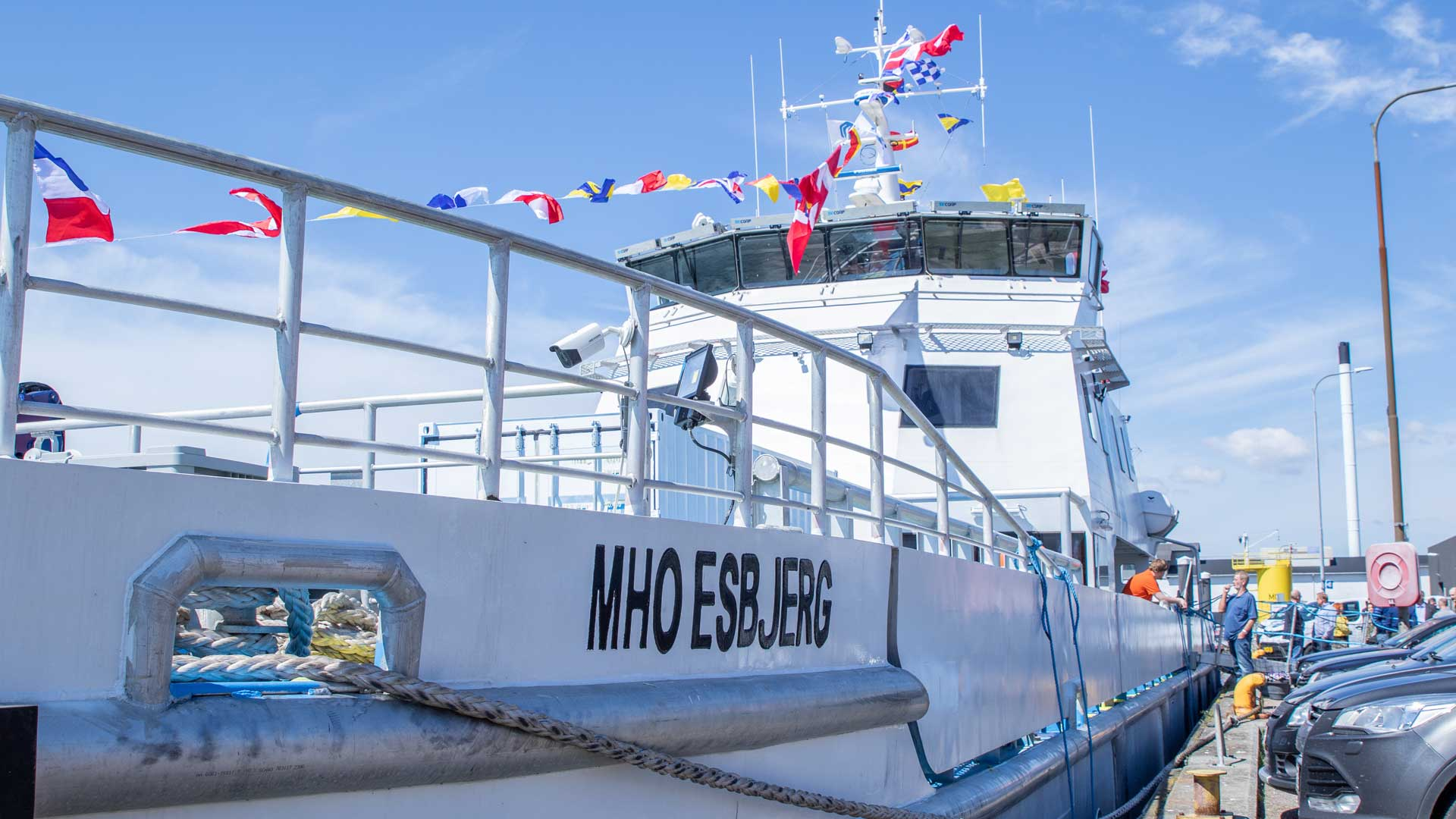 MHO Esbjerg ship from the dock - with nation flags blowing in the wind